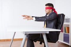 Blinder Geschäftsmann Stockfoto