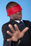 Blindfold african businessman Stock Photography