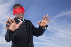 Blindfold african businessman Stock Images