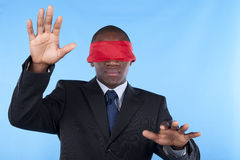 Blindfold african businessman Royalty Free Stock Photography