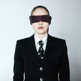 Blindfold business woman Stock Photo