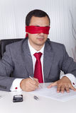 Blindfold businessman working Stock Photography