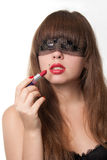 Blindfold and lipstick. The girl blindfold and lipstick near lips Stock Photos