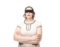 Blindfold plus size woman Stock Photo