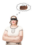 Blindfold plus size woman dreaming about cake Stock Photography
