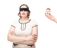 Blindfold plus size woman temptating with pastry Royalty Free Stock Images