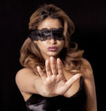 Blindfold woman making stop gesture Royalty Free Stock Photography