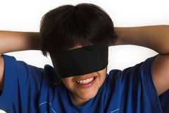 Blindfolded. Boy with blindfolding scarf Royalty Free Stock Photography