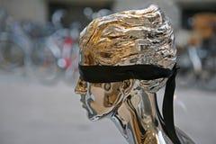 Blindfolded. Fashion model in show window Royalty Free Stock Image