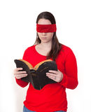 Blindfolded Bible reading Stock Image