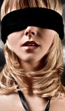 Blindfolded Blond Woman Closeup. Closeup Of A  Beautiful Blond Woman Blindfolded Royalty Free Stock Photography