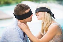 Blindfolded couple kissing Royalty Free Stock Images