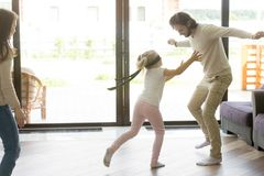 Blindfolded girl catching father playing hide and seek with fami Royalty Free Stock Images