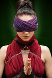 Blindfolded girl pray Royalty Free Stock Photography