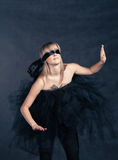 Blindfolded girl waiting. She weared black tutu Stock Image