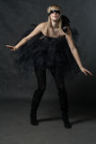 Blindfolded girl waiting. She weared black tutu Stock Photo