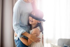 Family playing hide and seek at home, girl caught mother royalty free stock images