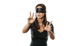 Blindfolded and lost. Lost blindfolded woman on a white background royalty free stock photos