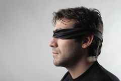 Blindfolded man Royalty Free Stock Photos