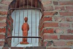 Blindfolded man behind bars Stock Photo