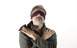 Blindfolded man over white background Stock Image