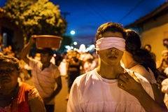 Blindfolded man in a procession in the streets of the city of Leon in Nicaragua during the Easter celebrations Stock Photo