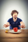 Blindfolded man wants to taste vegetables Stock Photography