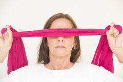 Blindfolded mature woman portrait Stock Photography