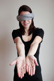 Blindfolded woman pulling hands forward Royalty Free Stock Photo