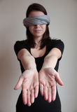 Blindfolded woman stretching arms forward Royalty Free Stock Photos