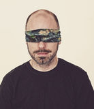 Blindfolded by the world. Stock Photo