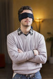 Blindfolded young man cannot see Royalty Free Stock Image