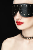 Blindness. Portrait of young beautiful woman in studded blindfold Stock Photo