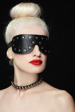 Blindness. Portrait of young beautiful blond woman in studded blindfold Royalty Free Stock Photography