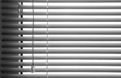 Blinds. Plastic blinds with draw string. White background stock photography