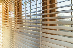 Blinds. Late afternoon sunlight through window blinds stock photos
