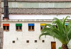 Blinds of colors. Old house with blinds of different colors that brighten the facade stock image