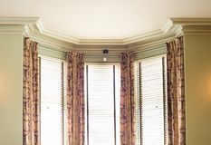 Blinds and curtains. In a nice looking house interior royalty free stock photo