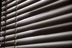Blinds in a home catching the sunlight,metal shutter window back. Ground.Blinds. Window blind. Blind Background royalty free stock image