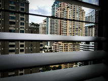 Blinds. Look through the blinds vertical, Cityscape of Bangkok, Afternoon Bangkok Royalty Free Stock Photography