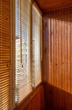 Blinds of natural materials on the balcony, wood-paneled Stock Image