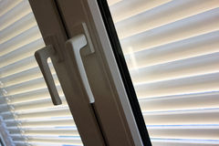 Blinds for sun protection on windows Royalty Free Stock Images