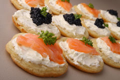 Blini. Group of blini, buffet food with salmon and lumpfish caviar stock images
