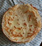 Blini. East Slavic dish. Blini - Slavic dish. Thin wheaten sweet dough fried in a pan. An indispensable attribute of the holiday Maslenitsa, also known as royalty free stock photos