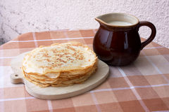 Blini with milk. Still Life with stack of pancakes and jug of milk Stock Photography