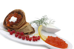 Blini with red caviar Stock Images
