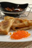Blini with red caviar Royalty Free Stock Photo