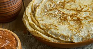 Russian classic Blini. Blini, Russian pancake traditionally made from wheat, 19th century classic cuisine , assorted dishes, Top view stock photography
