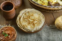 Russian classic Blini. Blini, Russian pancake traditionally made from wheat, 19th century classic cuisine , assorted dishes, Top view royalty free stock photography
