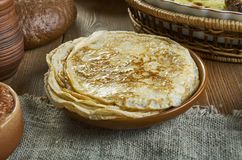 Russian classic Blini. Blini, Russian pancake traditionally made from wheat, 19th century classic cuisine , assorted dishes, Top view royalty free stock image